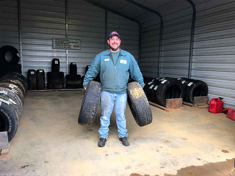David (inventory and parts manager) moving tires